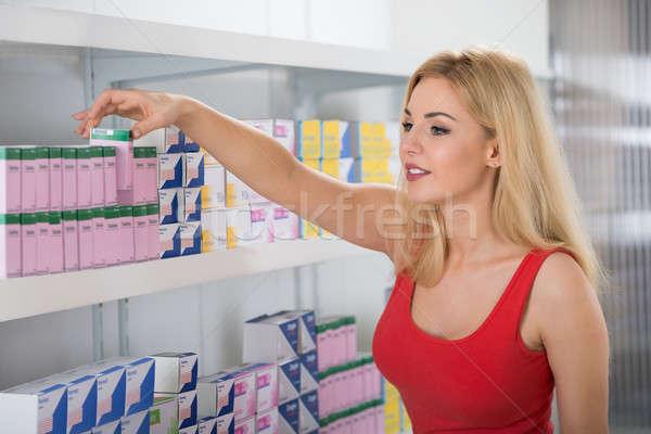 Woman Selecting Medicines At Pharmacy Stock photo © AndreyPopov