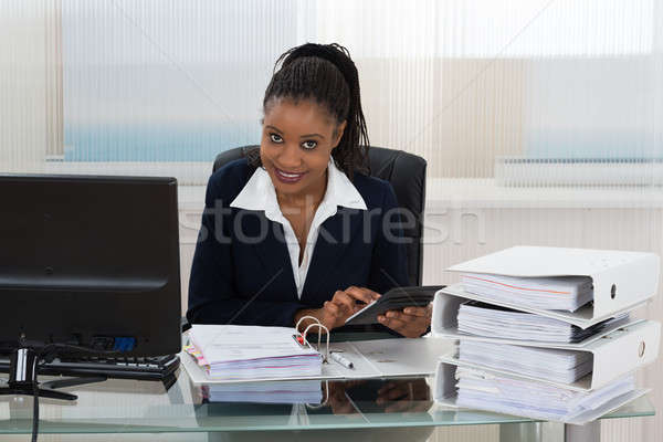 Businesswoman Calculating Bills Stock photo © AndreyPopov