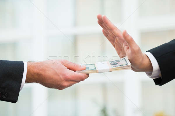 Businessman Refusing To Take Bribe From Partner Stock photo © AndreyPopov
