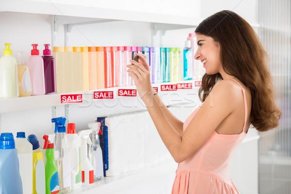 Stockfoto: Glimlachend · klant · cosmetische · producten · supermarkt