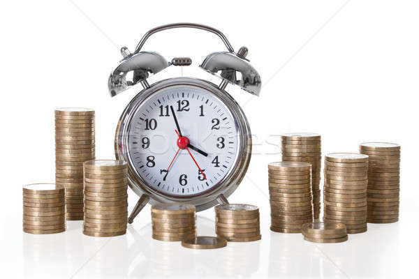 Alarm Clock And Coin Stacks Stock photo © AndreyPopov
