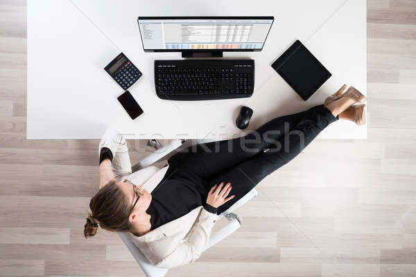 Businesswoman Relaxing On Chair Stock photo © AndreyPopov