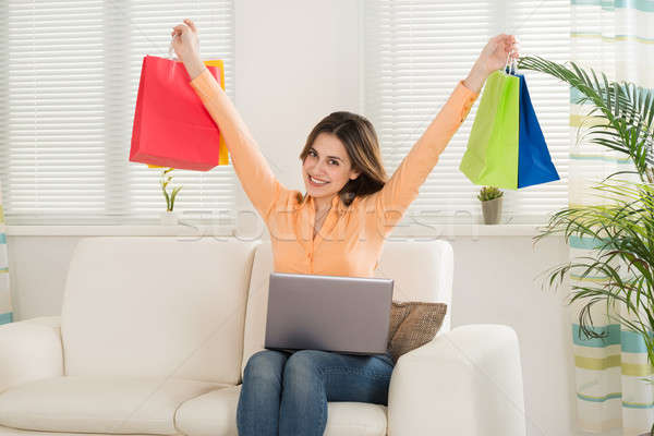 Woman Holding Multi-colored Shopping Bag Stock photo © AndreyPopov