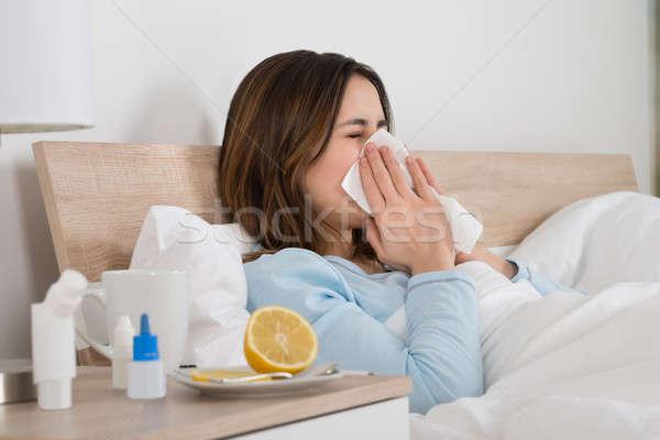Kadın enfekte soğuk yatak genç kadın burun üfleme Stok fotoğraf © AndreyPopov