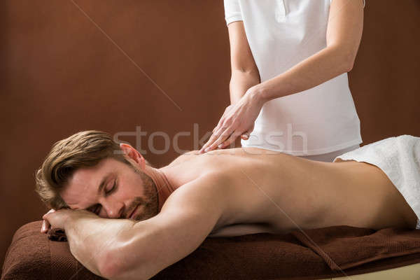 Young Man Receiving Back Massage At Spa Stock photo © AndreyPopov