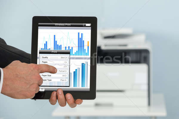 Businessman Using Tablet For Printing Graph Paper Stock photo © AndreyPopov