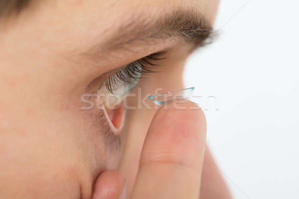 男 コンタクトレンズ 眼 クローズアップ 若い男 家 ストックフォト © AndreyPopov