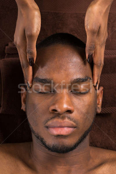 Man Getting Forehead Massage In Spa Stock photo © AndreyPopov