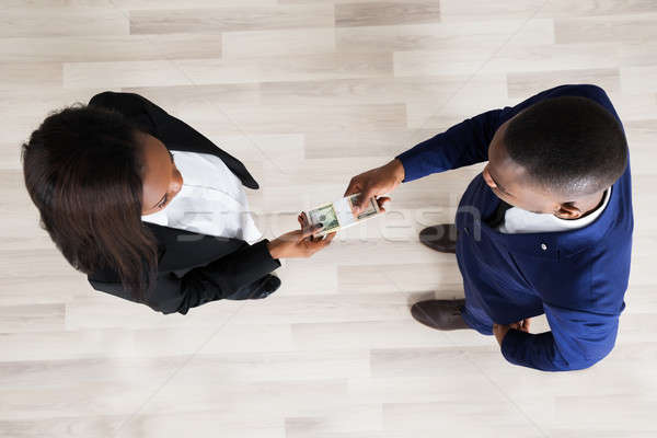 Business Man And Woman Exchanging Money Stock photo © AndreyPopov