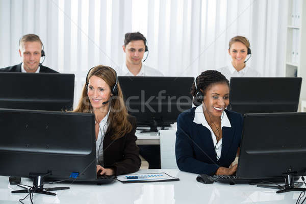 Team Of Businesspeople Working In Call Center Stock photo © AndreyPopov