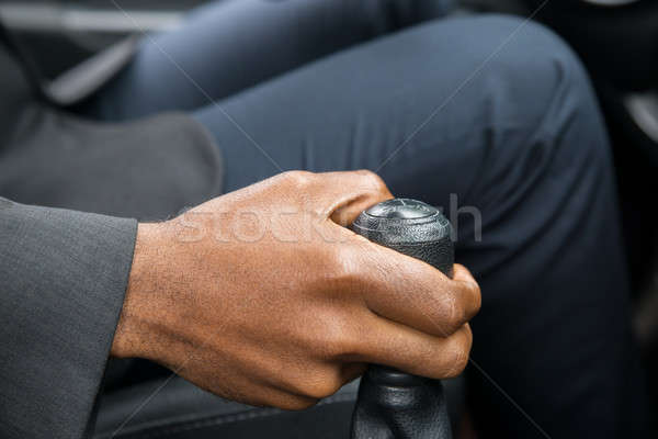 Person's Hand Changing Gear While Driving A Car Stock photo © AndreyPopov