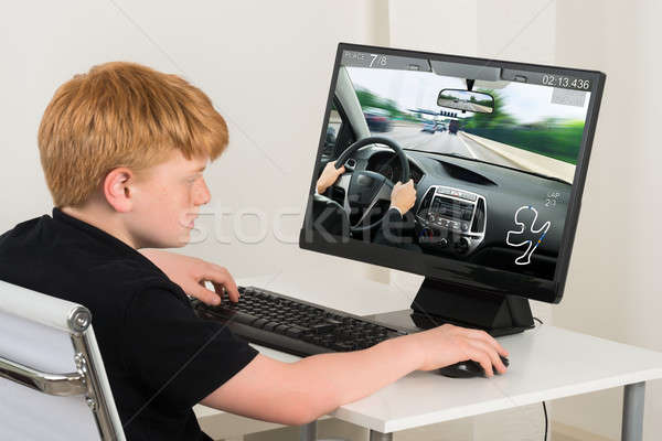 Boy Playing Car Game On Computer Stock photo © AndreyPopov