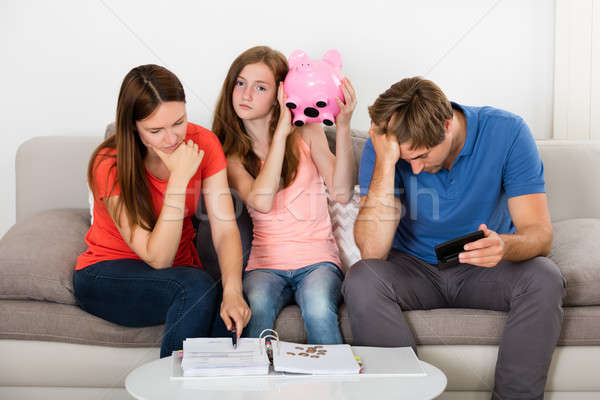 Girl Sitting On Sofa With Her Parent Stock photo © AndreyPopov