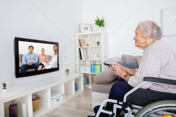 Handicapped Grandmother Watching Movie On Television Stock photo © AndreyPopov