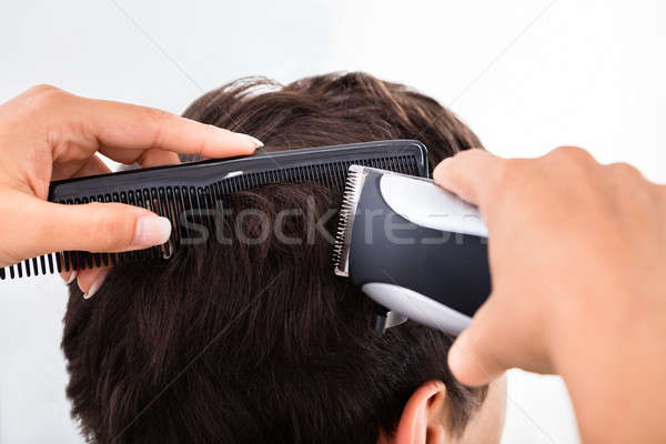Hairdresser Cutting Man's Hair With Electric Trimmer Stock photo © AndreyPopov