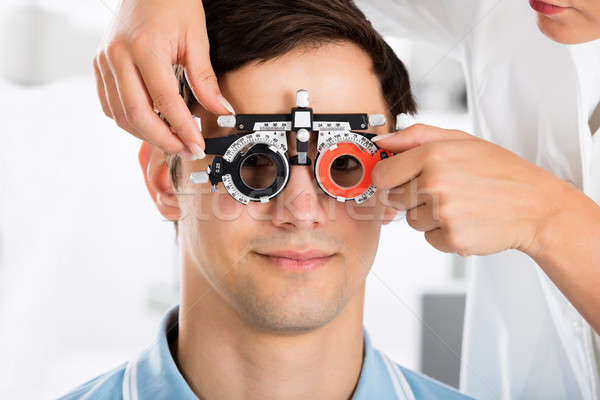 An Optometrist Checking Patient Vision With Trial Frame Stock photo © AndreyPopov