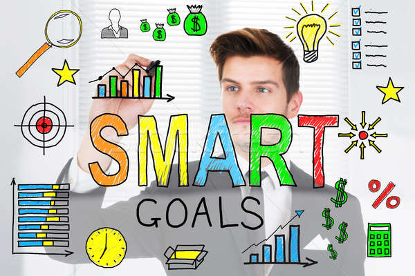 Businessman Drawing Smart Goals Concept On Glass Stock photo © AndreyPopov