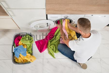 Stock photo: Person Using Plunger In The Sink