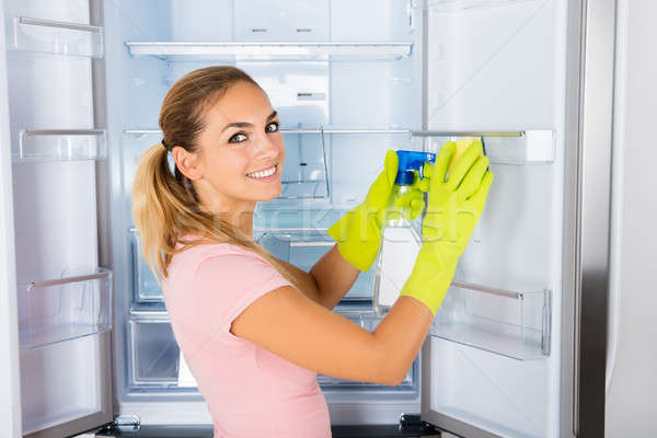 Woman Cleaning The Empty Refrigerator Door Stock photo © AndreyPopov
