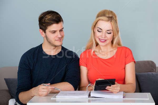 Mosolyog pár számla számológép fiatal család Stock fotó © AndreyPopov