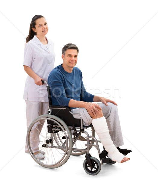 Feminino enfermeira inválido paciente cadeira de rodas retrato Foto stock © AndreyPopov