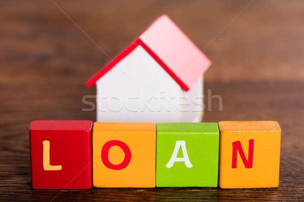 Miniatuur huis woord lening gekleurd Stockfoto © AndreyPopov