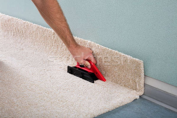 Craftsman's Hand Fitting Carpet Stock photo © AndreyPopov