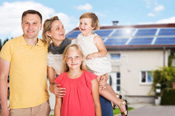 Happy Family Standing Outside The House Stock photo © AndreyPopov