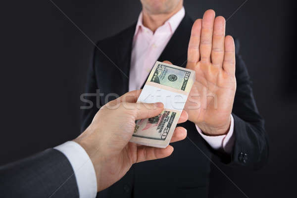 Businessman Refusing To Take A Bribe Stock photo © AndreyPopov