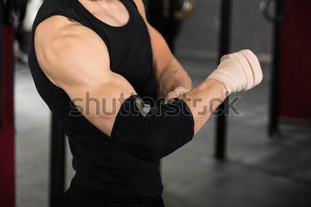 Athlete Person Wearing Bandage On Elbow Stock photo © AndreyPopov