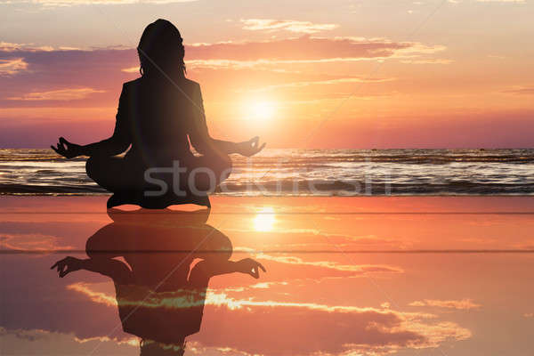 Silhouette Of A Woman Doing Yoga At Beach Stock photo © AndreyPopov