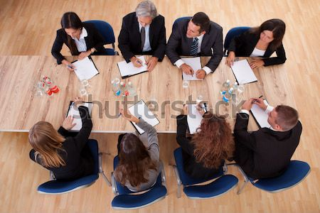 Business Team At Workplace In Office Stock photo © AndreyPopov