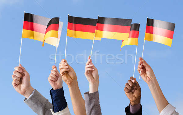Hands Holding German Flag Stock photo © AndreyPopov