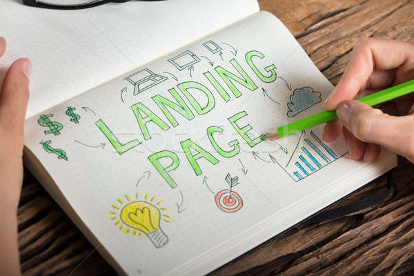 Human Hand Drawing Landing Page Concept On Notebook Stock photo © AndreyPopov