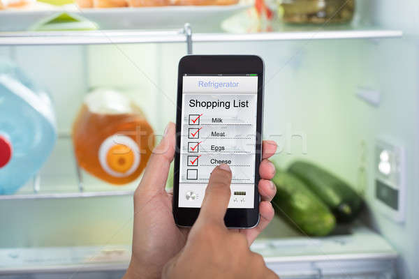 Person Hands Marking Shopping List On Mobile Phone Stock photo © AndreyPopov
