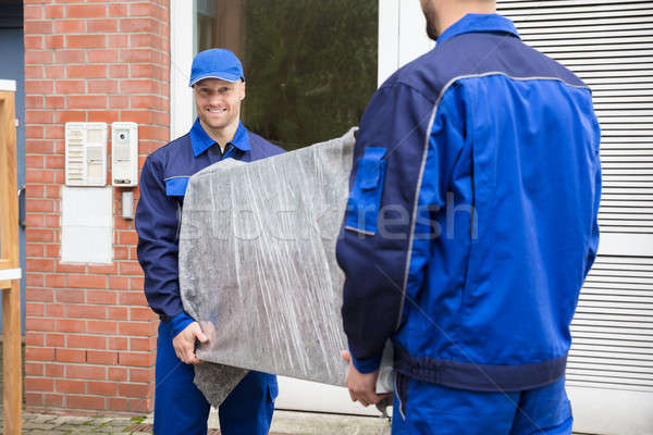 Two Male Movers Holding Furniture Stock photo © AndreyPopov