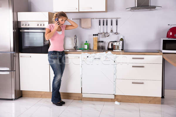 Woman Talking On Mobilephone Stock photo © AndreyPopov