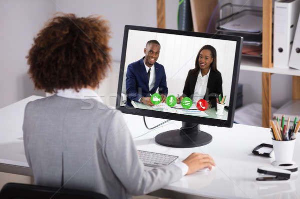 Businesswoman Video Conferencing Colleagues Stock photo © AndreyPopov
