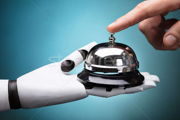 Person Ringing Service Bell Hold By Robot Stock photo © AndreyPopov