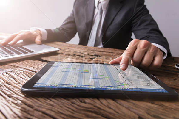 Businessman Working With Gantt Chart On Digital Tablet Stock photo © AndreyPopov