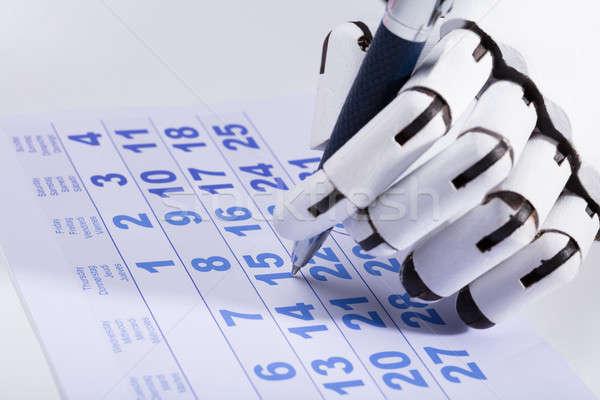 Robot data calendario primo piano robotico mano Foto d'archivio © AndreyPopov