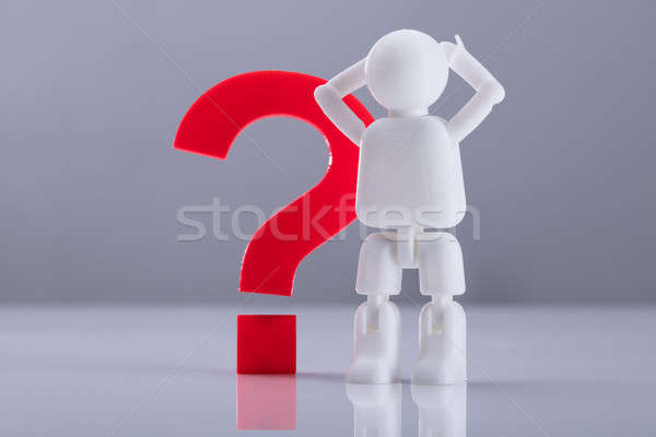 Human Figure Standing Beside Question Mark Sign Stock photo © AndreyPopov