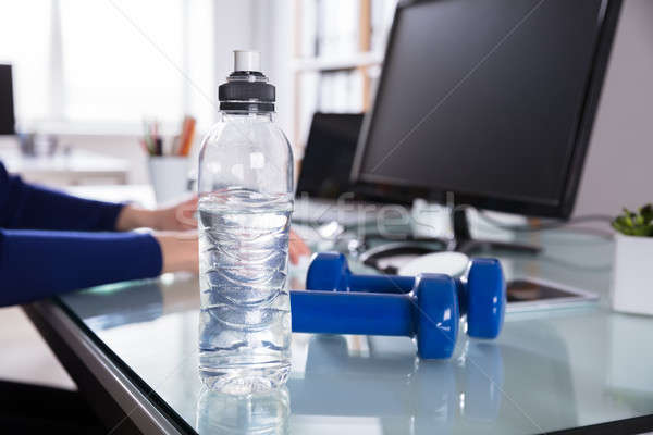 Close-up Of Water Bottle And Dumbbell Stock photo © AndreyPopov