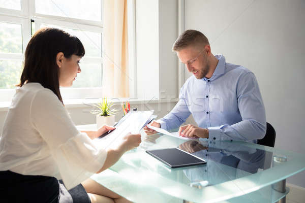 Two Businesspeople Looking At Document Stock photo © AndreyPopov