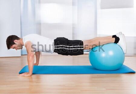 Megvizsgál sebesült láb ül fitnessz labda Stock fotó © AndreyPopov