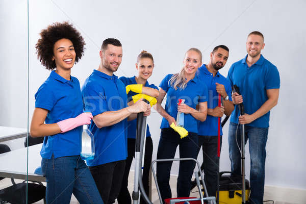 Portrait Of Happy Male And Female Janitors Stock photo © AndreyPopov
