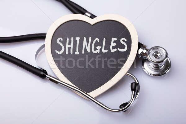 Stethoscoop hart woord cholesterol witte oppervlak Stockfoto © AndreyPopov