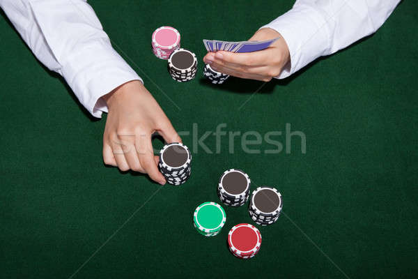 Poker player about to place a bet Stock photo © AndreyPopov