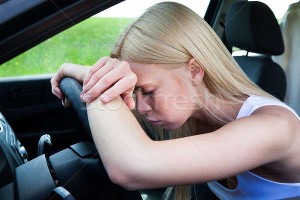 Kobieta głowie kierownica wyczerpany samochodu Zdjęcia stock © AndreyPopov