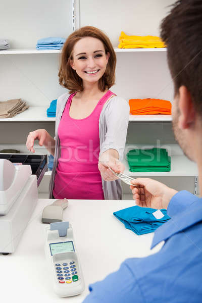 Stock photo: Client Handing Over Credit Card To A Cashier